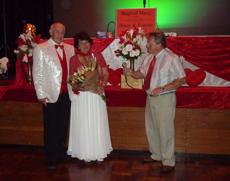 Henry & Jeannie Clark receiving flowers from David Wells of HeartSWell
